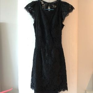 Short black floral lace dress with open back